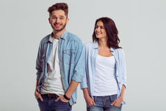Beautiful young couple in jeans Stock Photos