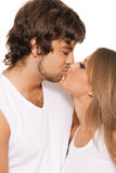 Beautiful young couple kissing Stock Photography