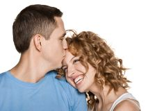 Beautiful young couple kissing Stock Photos