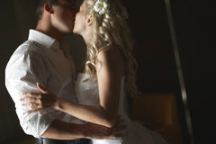Beautiful young couple kissing with emotional embrace. Royalty Free Stock Photos