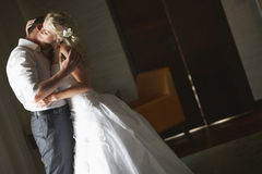 Beautiful young couple kissing with emotional embrace. Stock Photos