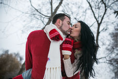 Beautiful young couple kissing in the park Royalty Free Stock Image