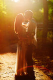 Beautiful young couple kissing in the sunset Stock Photo