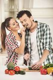 Beautiful young couple in the kitchen while cooking stock photo
