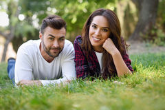 Free Beautiful Young Couple Laying On Grass In An Urban Park. Stock Photos - 93668793