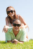 Young Couple lie down on grass. And smile royalty free stock photos