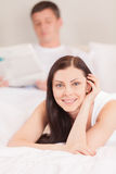 Beautiful young couple ling in bed. Stock Photo