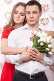 Beautiful young couple in love with a bouquet of flowers. Valentine's Day. Stock Photo