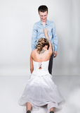 Beautiful young couple in love, bride knelt before the groom. provocation playful couple Stock Image
