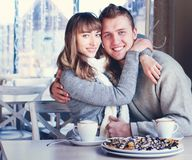 Beautiful Young Couple in Love in cafe Stock Photos