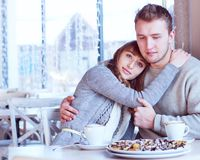 Beautiful Young Couple in Love in cafe Royalty Free Stock Images
