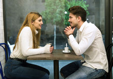 Beautiful young couple in love at a coffee shop. Stock Photo