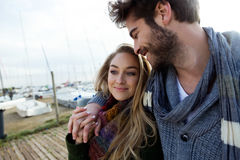 Beautiful young couple in love in a cold winter on the beach. Stock Image