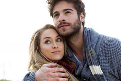 Beautiful young couple in love in a cold winter on the beach. Royalty Free Stock Photos