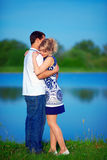 Beautiful young couple in love dating  near the lake Stock Photography