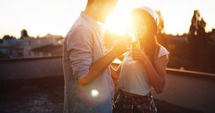 Beautiful couple in love dating outdoors and smiling stock image