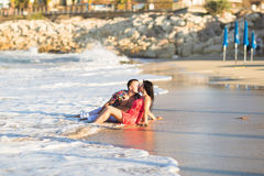 Beautiful young couple in love enjoying and having fun at the beach Royalty Free Stock Images