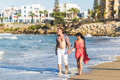 Beautiful young couple in love enjoying and having fun at the beach Stock Image