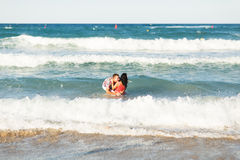 Beautiful young couple in love enjoying and having fun at the beach Royalty Free Stock Photos