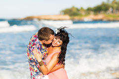 Beautiful young couple in love enjoying and having fun at the beach Stock Photo
