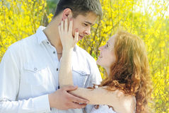 Beautiful young couple in love among the flowering trees Royalty Free Stock Photos