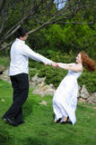 Beautiful young couple in love on a green glade Stock Photos