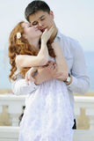 Beautiful young couple in love near the sea Royalty Free Stock Image
