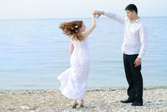 Beautiful young couple in love near the sea Royalty Free Stock Images