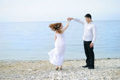 Beautiful young couple in love near the sea Stock Images