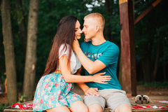 Beautiful young couple in love outdoors, rose Stock Photos