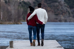 Beautiful young couple in love over winter background. Stock Photos