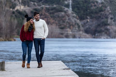 Beautiful young couple in love over winter background. Royalty Free Stock Image