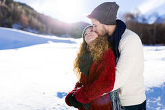 Beautiful young couple in love over winter background. Royalty Free Stock Photo