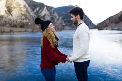 Beautiful young couple in love over winter background. Stock Photo