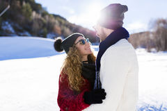 Beautiful young couple in love over winter background. Royalty Free Stock Photos