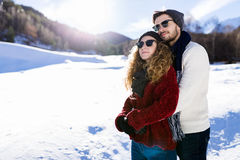 Beautiful young couple in love over winter background. Royalty Free Stock Images