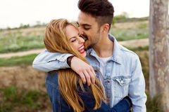 Beautiful young couple in love in the park. Portrait of beautiful young couple in love in the park Stock Photos