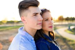 Beautiful young couple in love in the park. Royalty Free Stock Photography