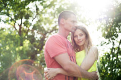 Beautiful young couple in love. Sunny summer nature. Royalty Free Stock Photography