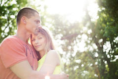 Beautiful young couple in love. Sunny summer nature. Royalty Free Stock Images
