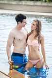 Beautiful young couple in love together in swimming pool.  Stock Images