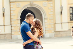 Beautiful young couple in love walking on urban background. Holding hands Stock Photography