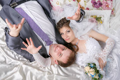 Beautiful young couple lying on bed Royalty Free Stock Images