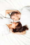 Beautiful young couple lying down Royalty Free Stock Image