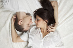 Beautiful young couple lying down Stock Photography