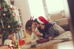 Loving couple on Christmas morning royalty free stock photos