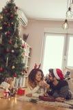 Loving couple on Christmas morning stock photo