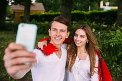 Beautiful young couple makes selfie Stock Photos