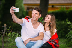 Beautiful young couple makes selfie Stock Images