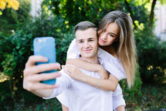 Beautiful young couple makes selfie Royalty Free Stock Image